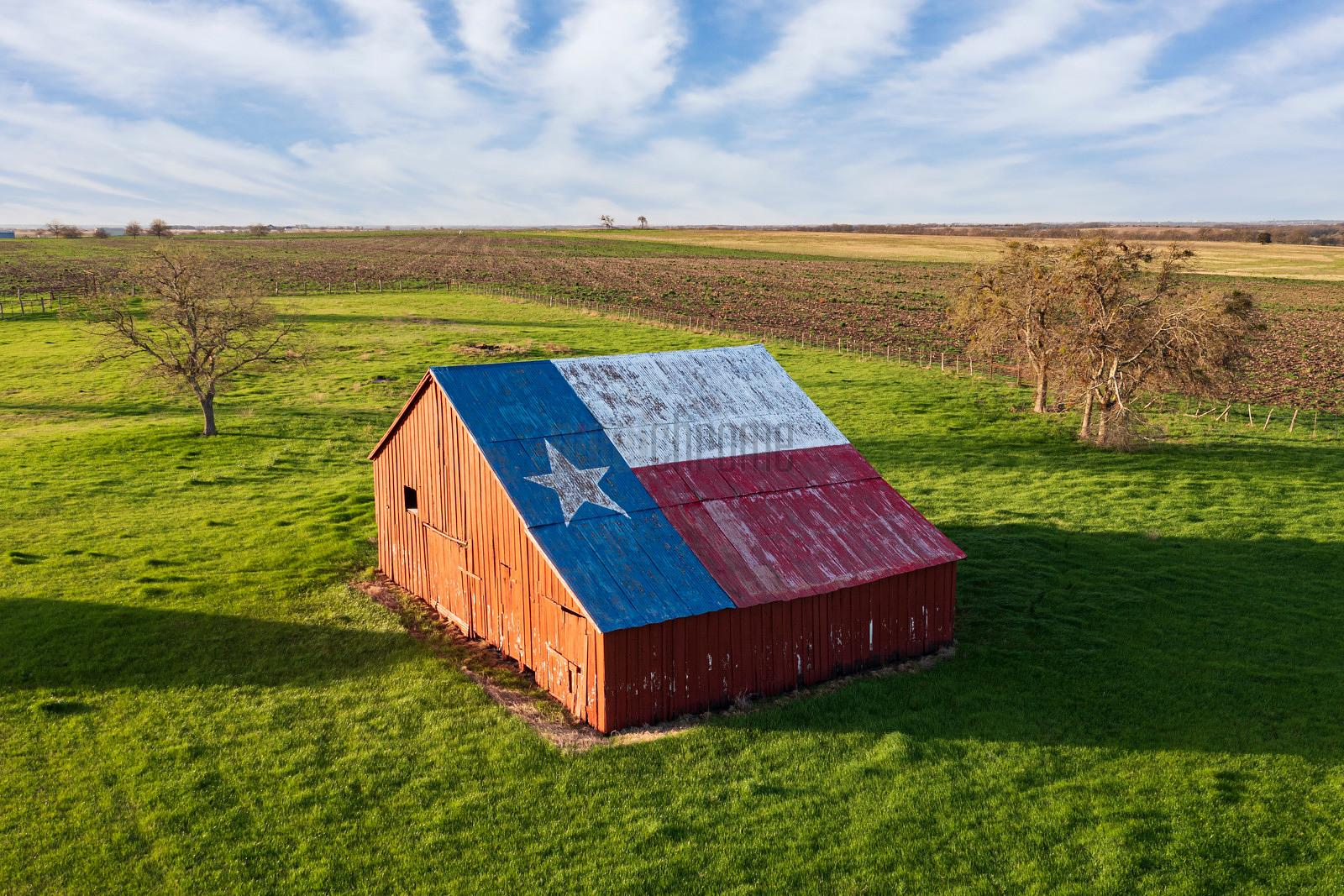 Barn With Texas Flag Painted on the Roof