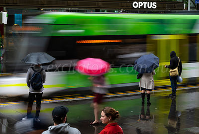 Commuters, wet day in Melbourne
