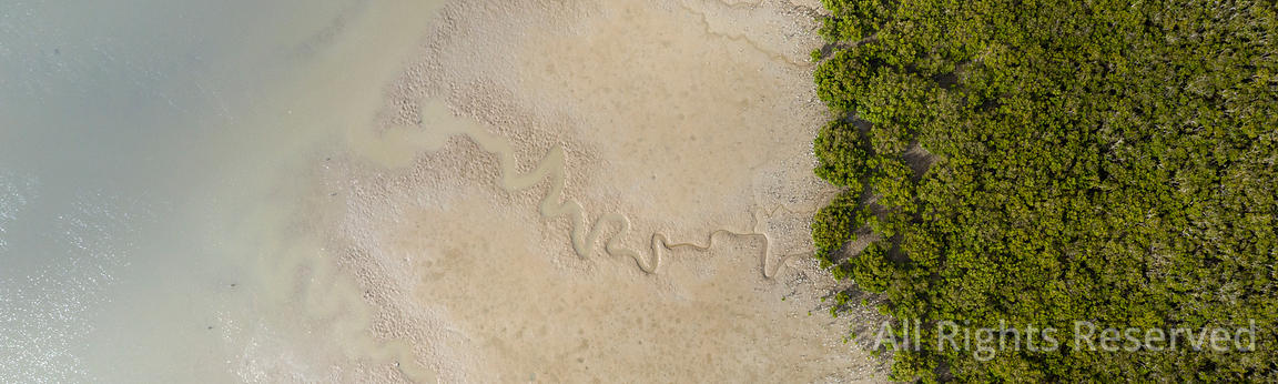 Top View of a Shore in Matakohe Area During Low Tide, New Zealand. Some of the Sand Pattern Shows Trhrough the Clear Water, a...