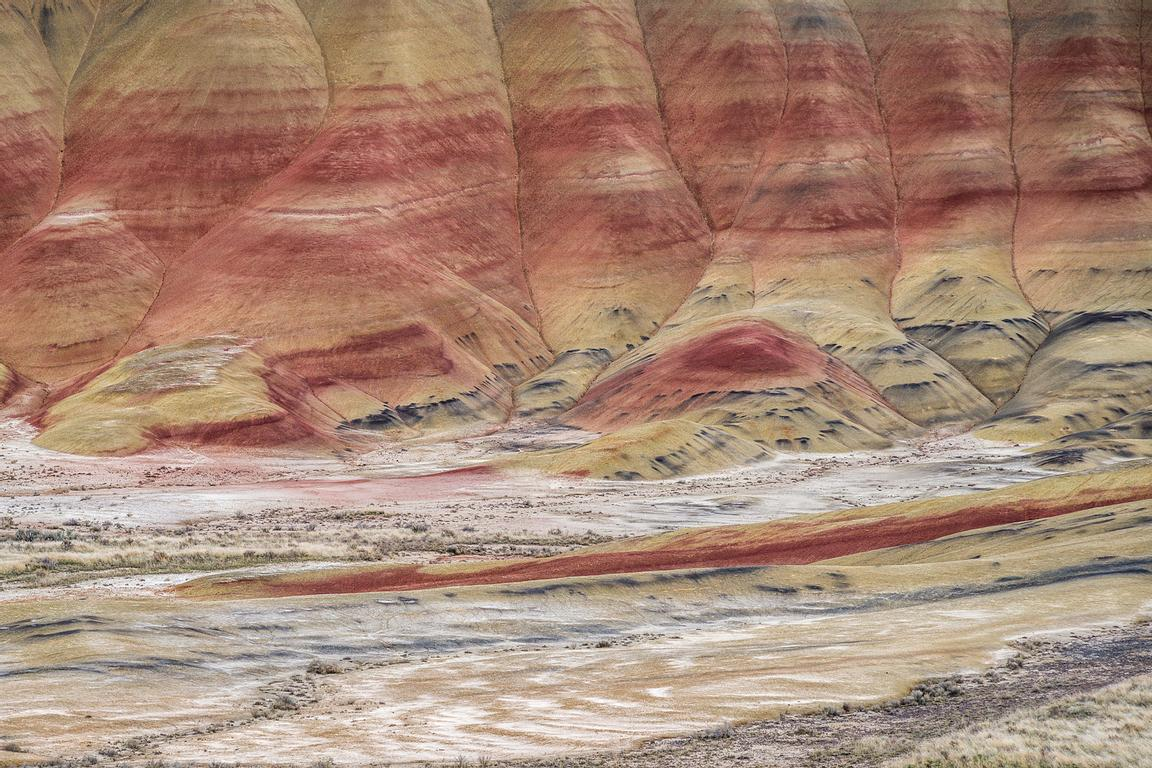 Colourful bands of vocanic ash deposited over the last forty million years create dramatic scenery in the Painted Hills of Or...