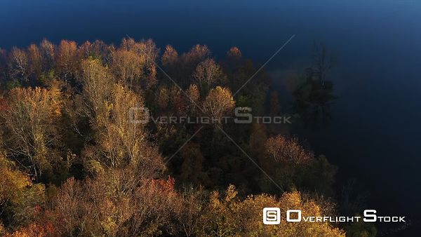 Island in the Shadows, with Sunrise Highlighted Fall Colors, Owings Mills, Maryland, USA