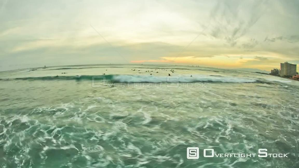 Beautiful time lapse clip of waves and surfers during sunset  Hawaii