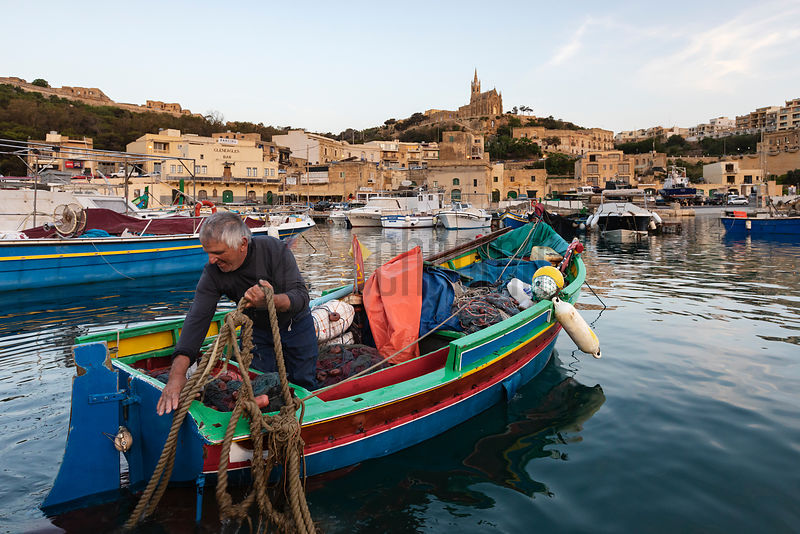 A Maltese Fisherman Moors his Boat at the Harbour at Mgarr