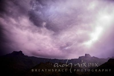 Thunderstorm clouds and lightning over the Amphiteatre escarpment mountains and foothills